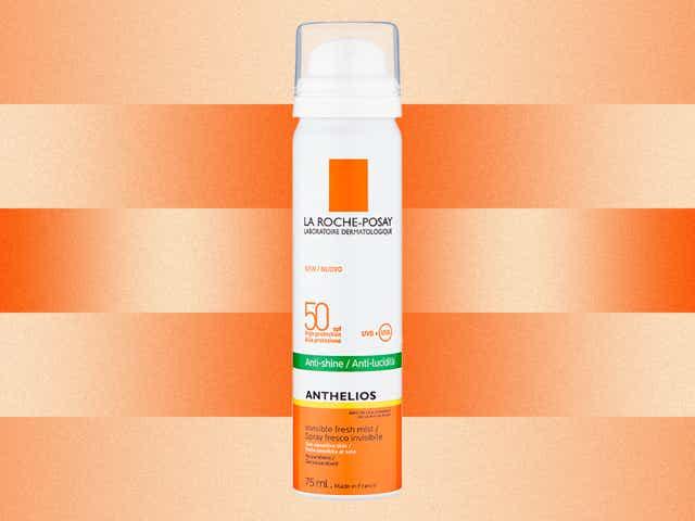 La Roche-Posay Anthelios Anti-Shine Face Mist SPF 50 on orange gradient background