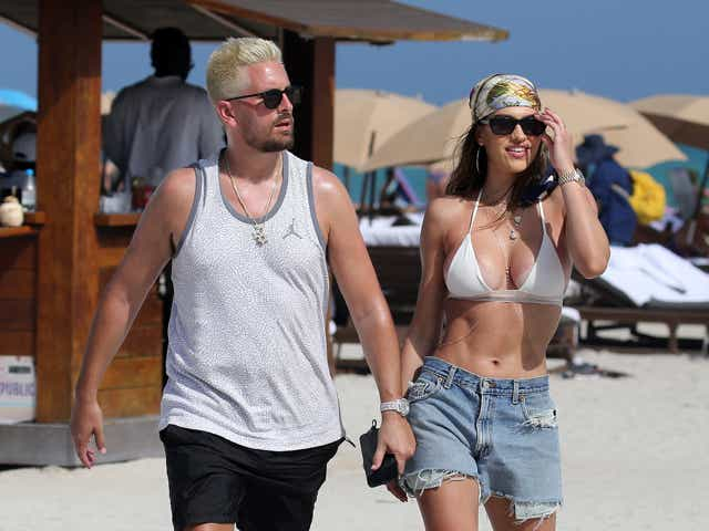 Scott Disick and Amelia Hamlin are seen on February 14, 2021 in Miami, Florida.