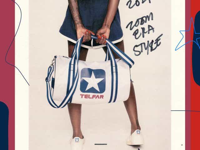 model carries a telfar x converse white and blue duffel bag