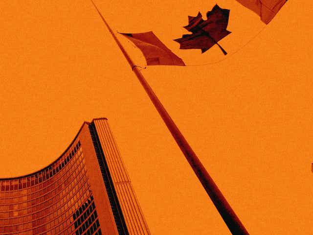 A Canadian flag at half-mast on an orange background