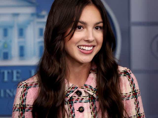 Pop music star and Disney actress Olivia Rodrigo makes a brief statement to reporters.