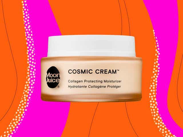 Jar of Moon Juice Cosmic Cream moisturizer against a pink and orange swirly background