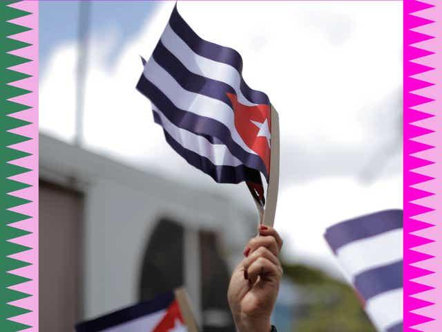 Cuban flags waving in the air.