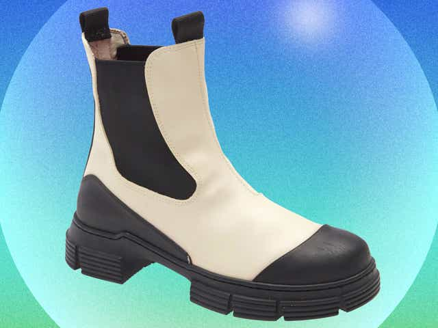 A Ganni boot on a blue and green background