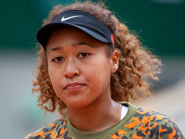 Naomi Osaka of Japan during practice on Court Philippe-Chatrier during a practice match against Ashleigh Barty of Australia.