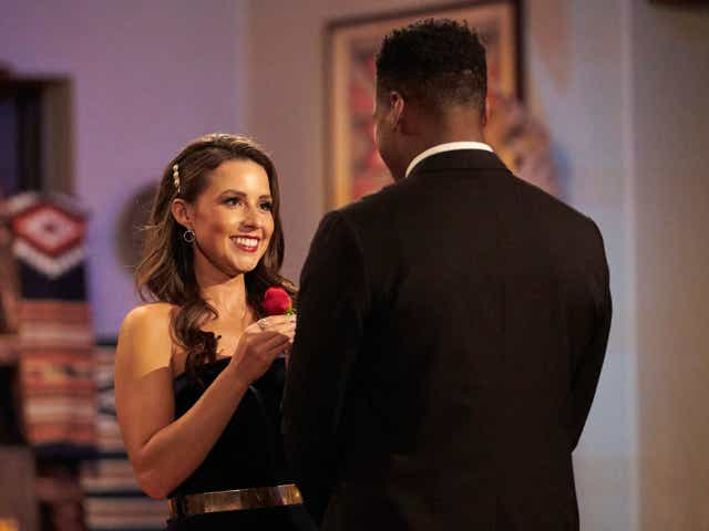 Katie gives a rose to a contestant on The Bachelorette.