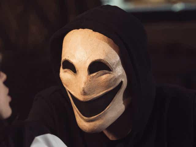 man wearing a creepy mask