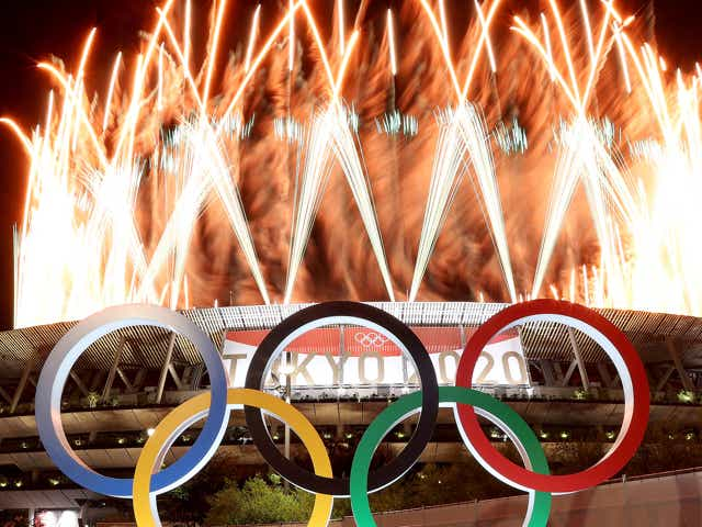 The Olympic Rings are seen outside the stadium as fireworks go off during the Opening Ceremony of the Tokyo 2020 Olympic Games.