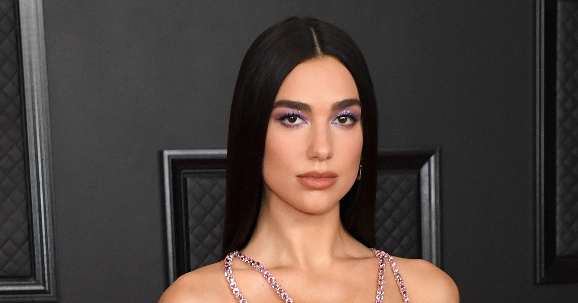 Dua Lipa Paired A Neon Suit With This Season's Hottest Swim Trend