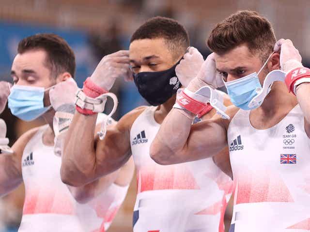 James Hall, Joe Fraser, Giarnni Regini -Moran, and Max Whitlock of Team Great Britain don masks ahead of the Men's Team Final.