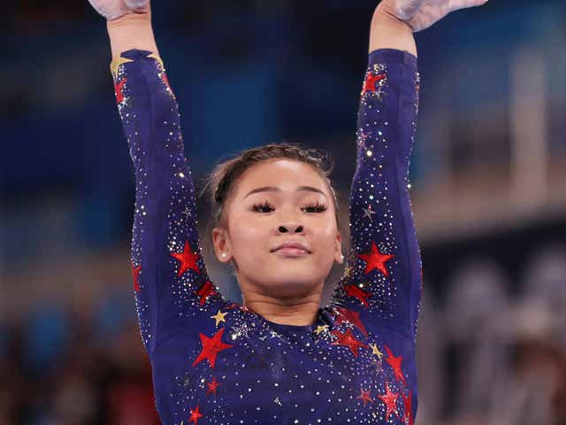 Sunisa Lee of Team United States reacts after competing on balance beam during Women's Qualification.
