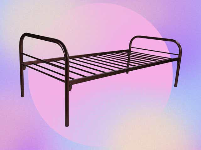 A metal bed frame on a colorful background.