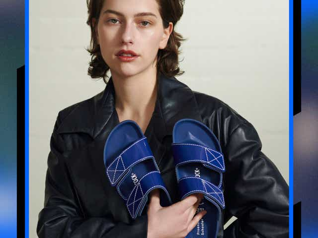 a model poses with a pair of blue sandals from proenza schouler x birkenstock
