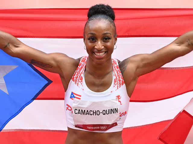 Jasmine Camacho Quinn of Puerto Rico celebrates after winning the gold medal in the Women's 100m Hurdles Final.