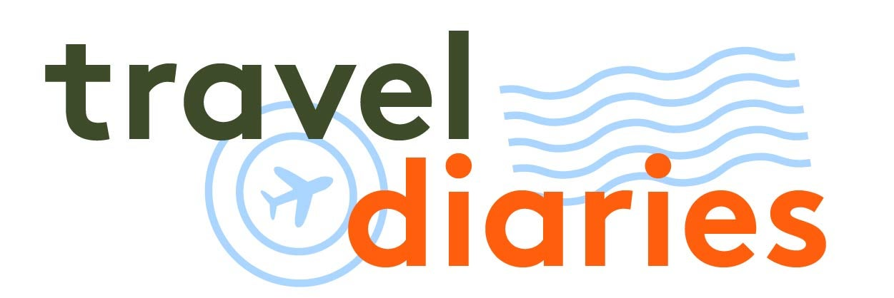 The Travel Diaries logo in green and orange lettering with an airplane inside two circles.