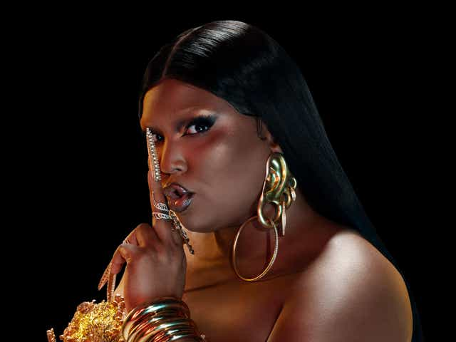 Lizzo puts a finger to her lips shhhh-ing the haters