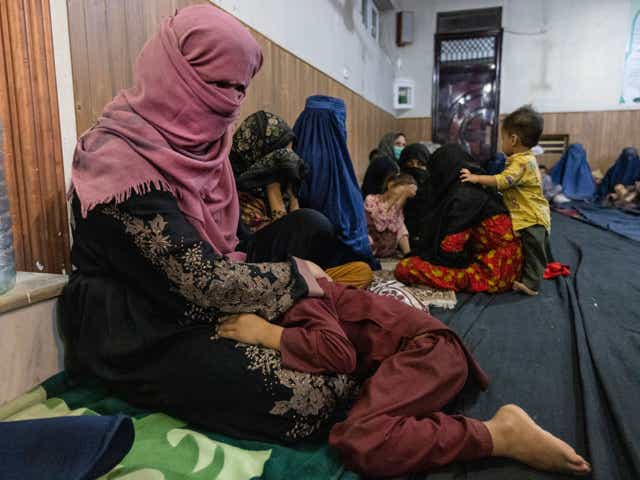 Displaced Afghan women and children from Kunduz at a mosque that is sheltering them on August 13, 2021 in Kabul, Afghanistan
