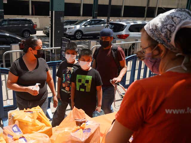 A local family receives food items as Food Bank For New York City teams up with the New York Yankees.