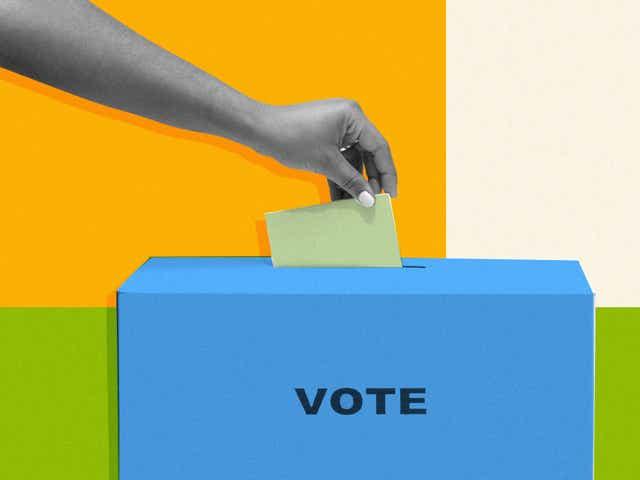 A person dropping off a ballot