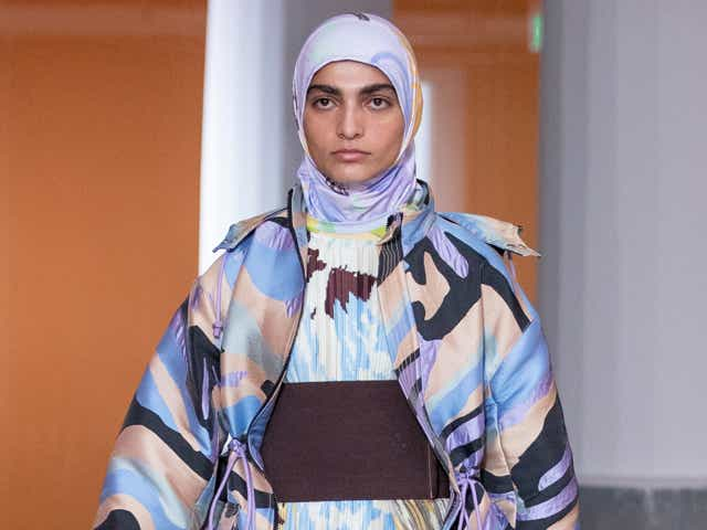 A model in a printed look from Stine Goya's Spring 2022 show.