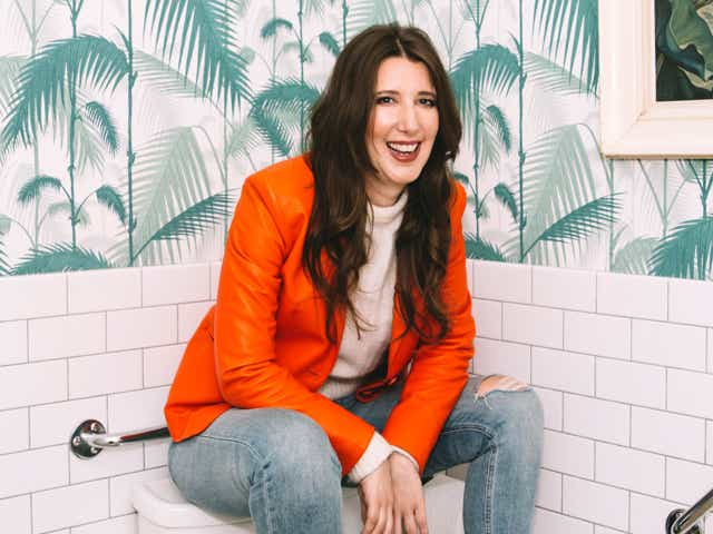 An image of Jen Agg sitting on top of a toilet