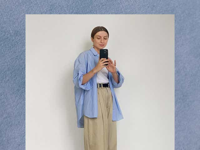 Brittany wears blue shirt and beige trousers