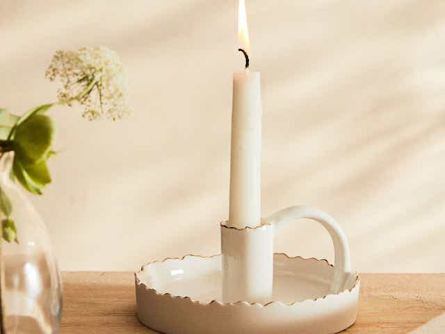 White candle in candlestick holder
