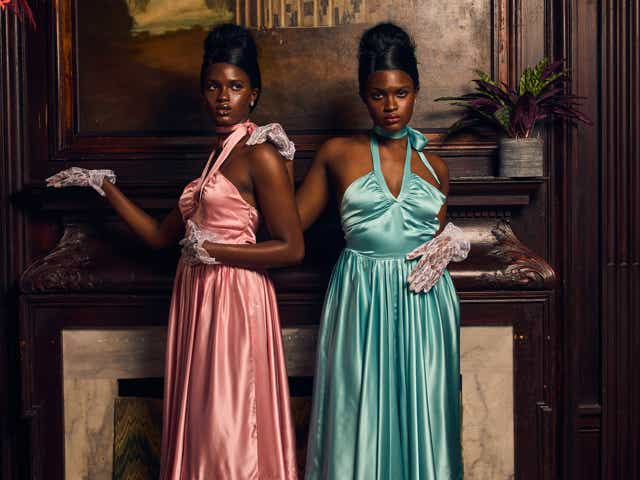 two women wear pink and blue halter dresses