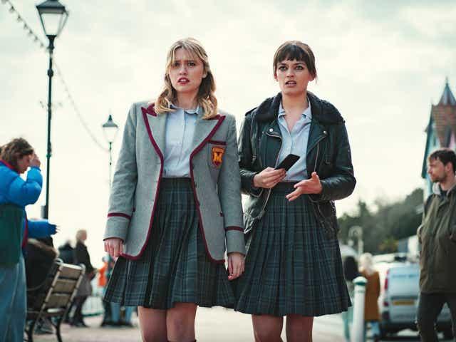 Two girls in school uniforms
