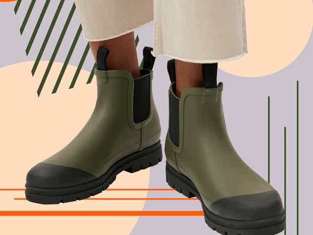 Model wearing rain boots from Everlane