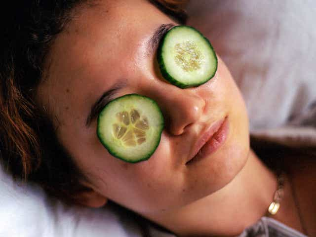 Model with cucumbers over her eyes