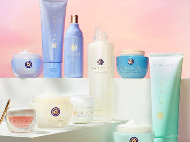 Various Tatcha skincare products on a white display