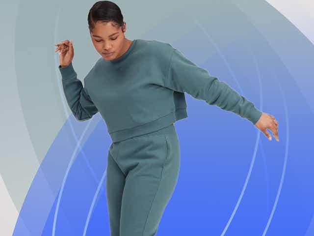 Woman in Girlfriend sweatsuit