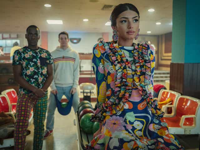 Ruby Matthews, Eric Effiong and Adam Groff pictured at a bowling alley in the hit Netflix show Sex Education