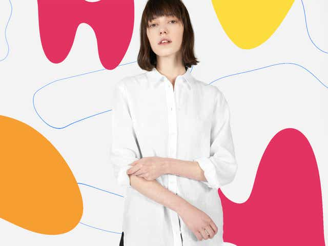 Model wearing a white button-down from Everlane.