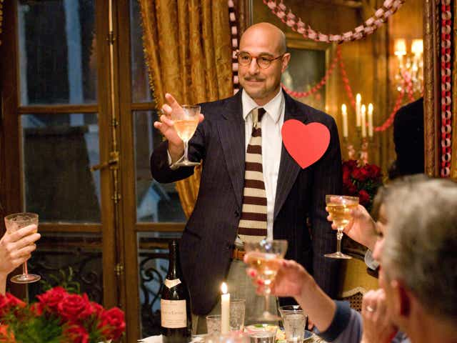 Paul Child (Stanley Tucci) making a toast in Julie & Julia (2009)