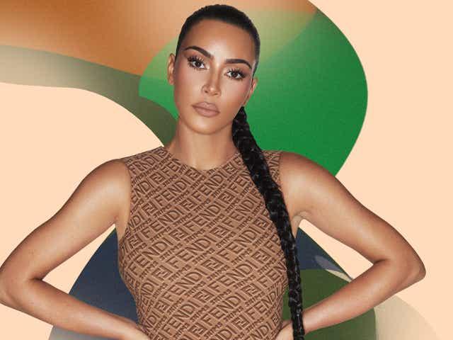 kim kardashian wears a brown bodysuit from fendi x skims