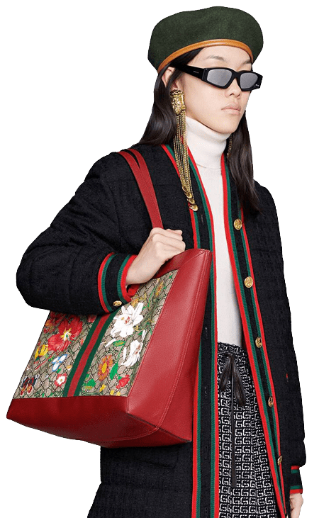 Woman holding a Gucci tote