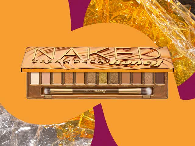Urban Decay Naked Honey palette shown on a colorful background.