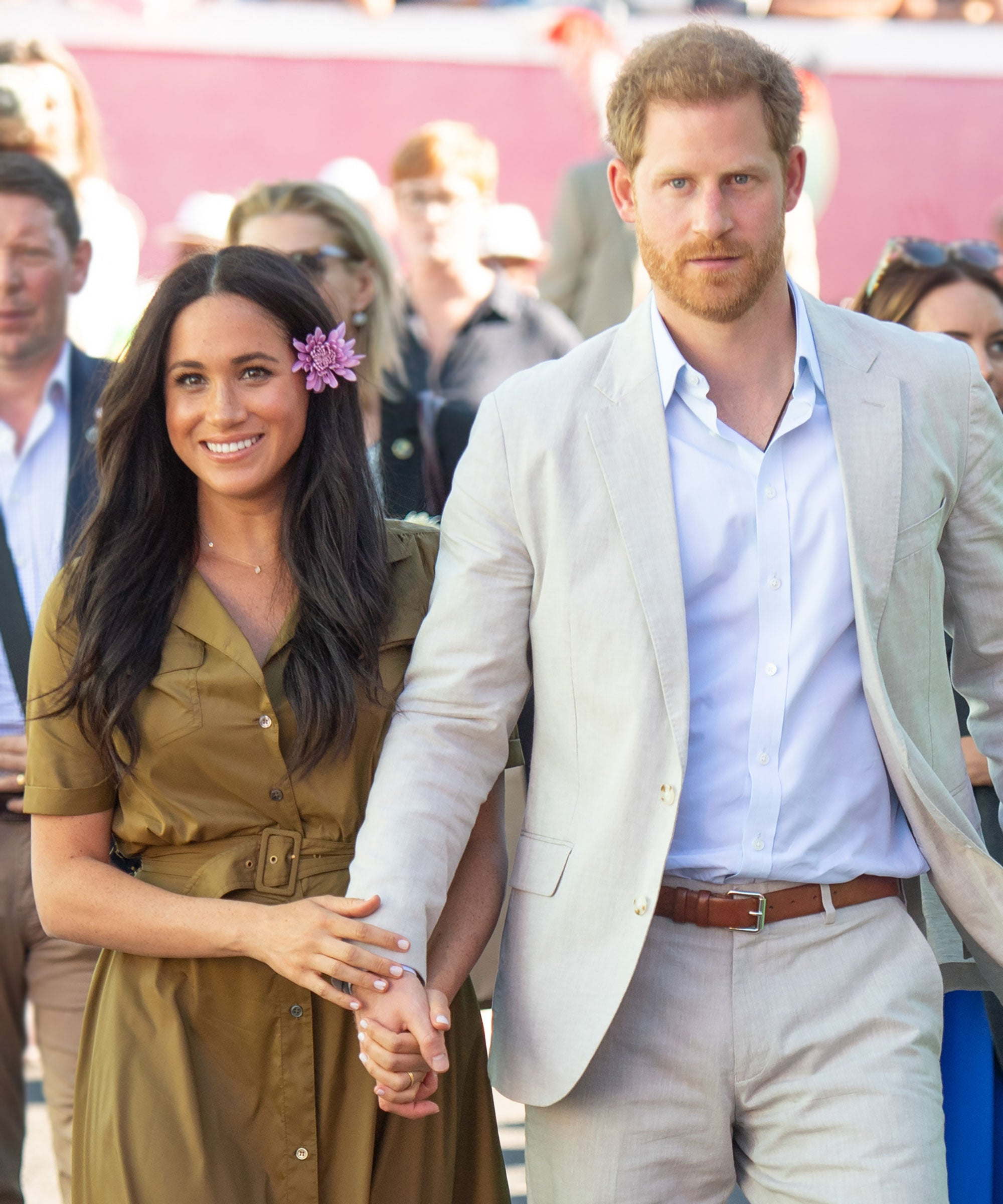 Prince Harry & Meghan Markle Will Leave Their HRH Titles Behind — But Not The Royal Family