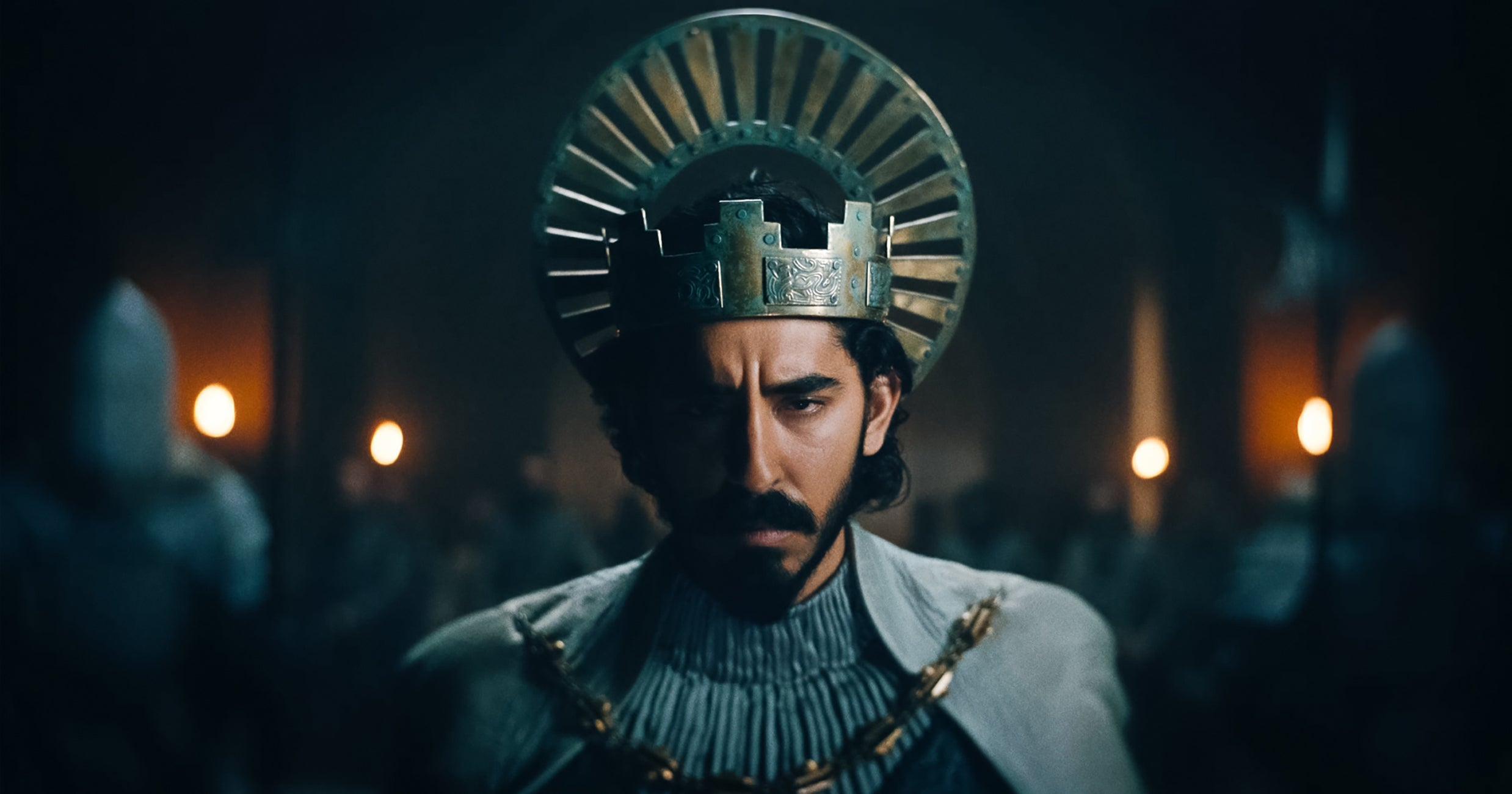 Dev Patel His Flowing Locks Take The Crown In The Green Knight Trailer