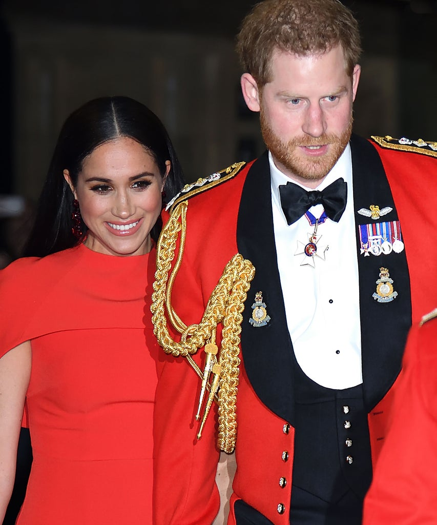 Harry & Meghan's Matching Red Outfits Ahead Of Their Royal Exit Have A Hidden Meaning 1