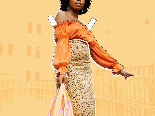 A woman in an leopard print skirt and a orange off-the-shoulder top carries a purse in front of a digital background