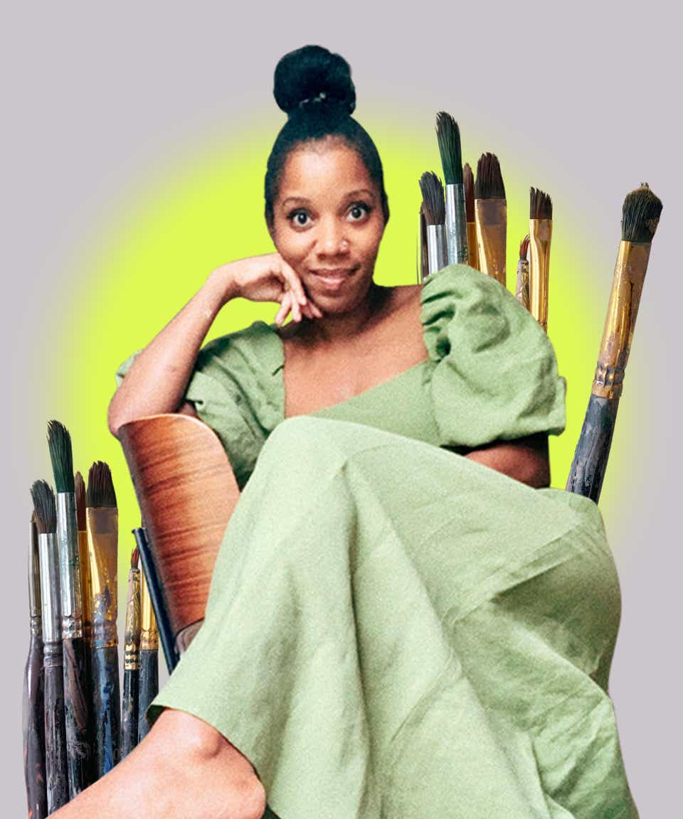 Stylist Stephanie Thomas smiles widely for the camera with her hand on her chin. She is wearing a green dress, nude lipstick, and her hair styled in a topknot. Behind her is a graphic of paintbrushes, indicating her work as an artist.