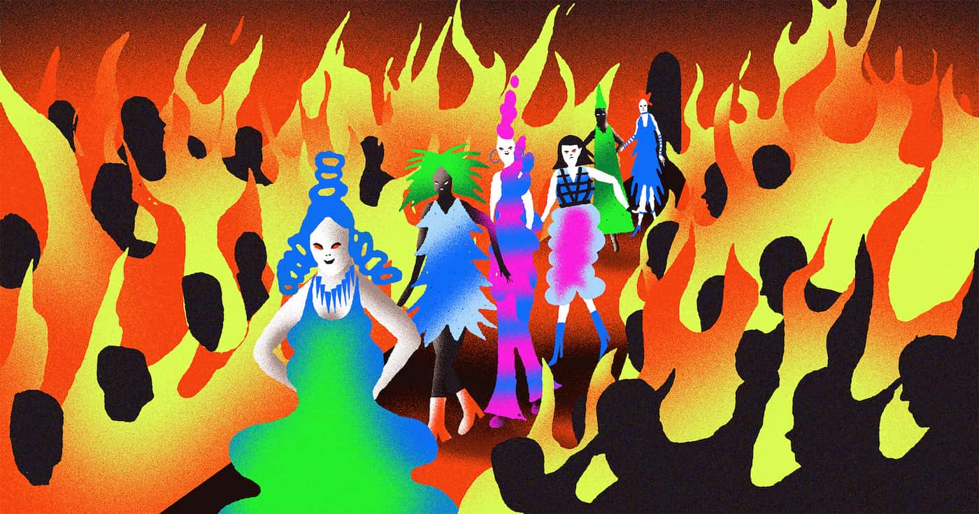 Fashion models walking down the runway that is engulfed in flames